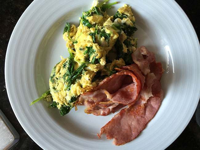 Eggs, spinach, and turkey bacon.