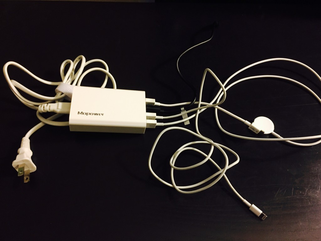 Mopower four port travel charger with two USB chargers, an Apple Watch charger, and an Apple Lightning cord