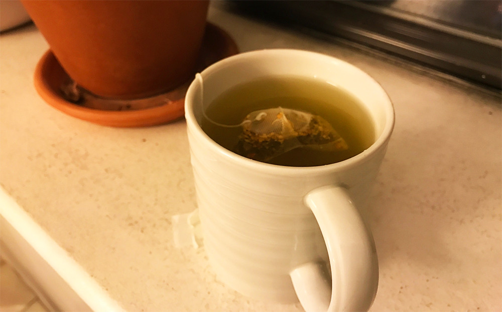 A cup of Rishi tumeric ginger tea.